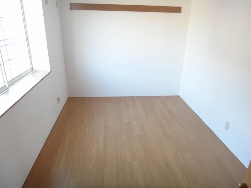 ピーチランド B 01010号室の居室
