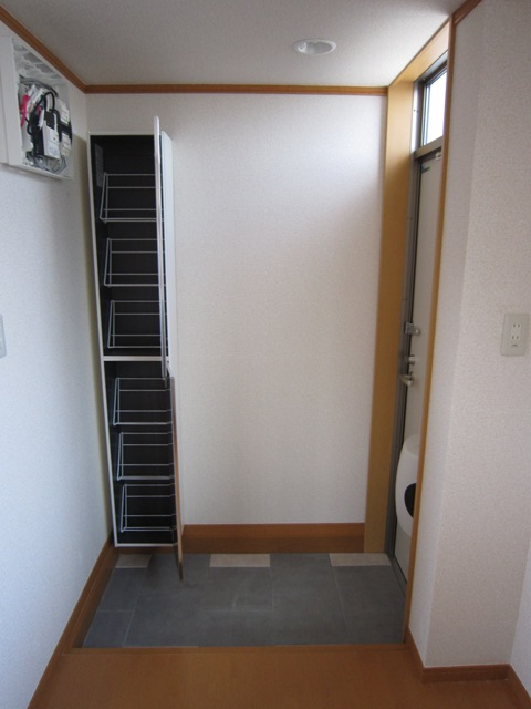 コンフォート樋ノ爪 102号室の玄関