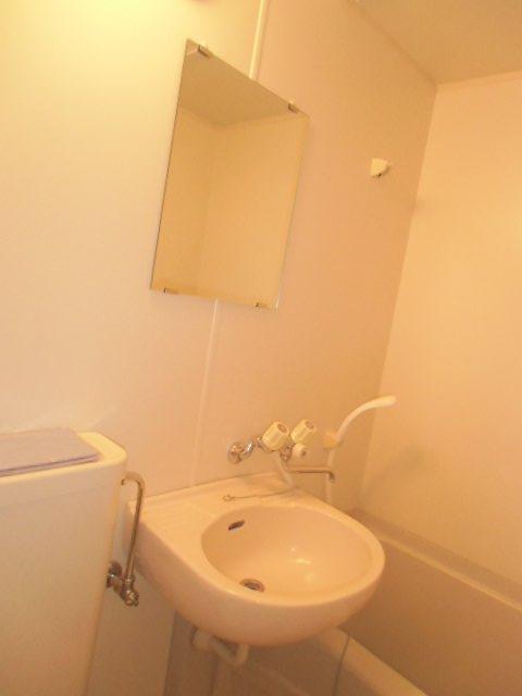 ラビデンススグモ 102号室の洗面所