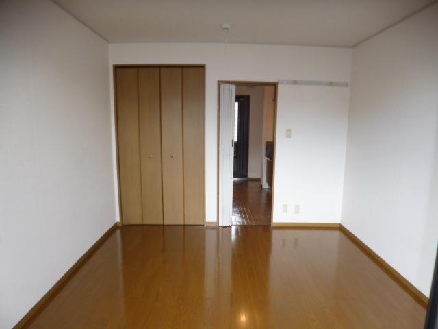 セジュール・オオムラ 102号室のベッドルーム