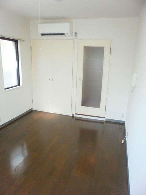 RX豊田 205号室のベッドルーム