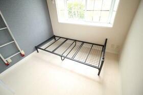 ベルピア六実第1-1 203号室のベッドルーム
