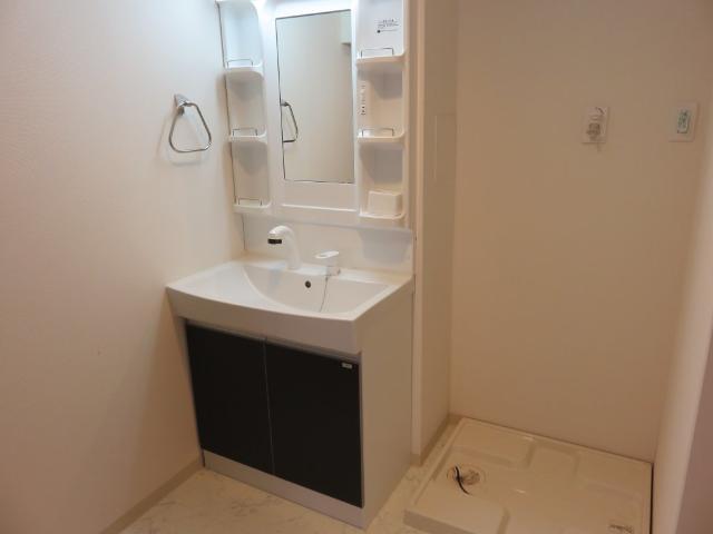 (仮称)平塚市紅谷町マンション新築工事 00401号室の洗面所