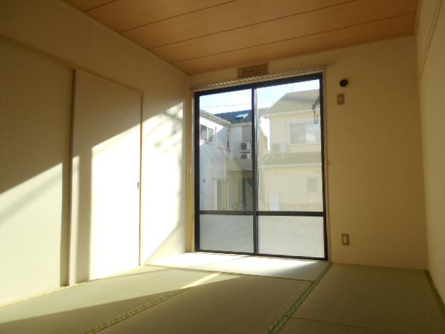 グリーンヒルTOMURO D 101号室のベッドルーム