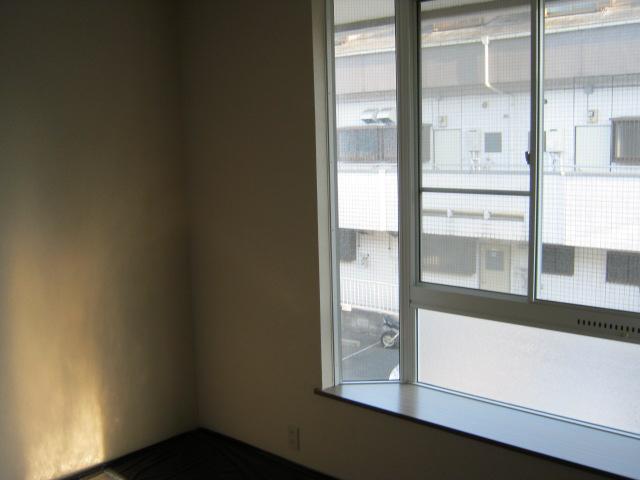 第2ニューリース神崎 201号室のベッドルーム