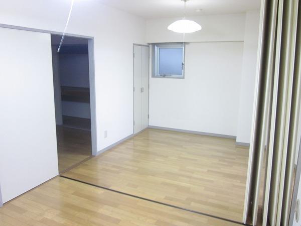 トーレタケダ 205号室のベッドルーム