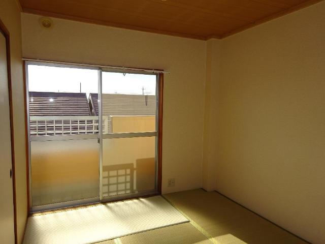 ロイヤルコープM 00301号室のベッドルーム