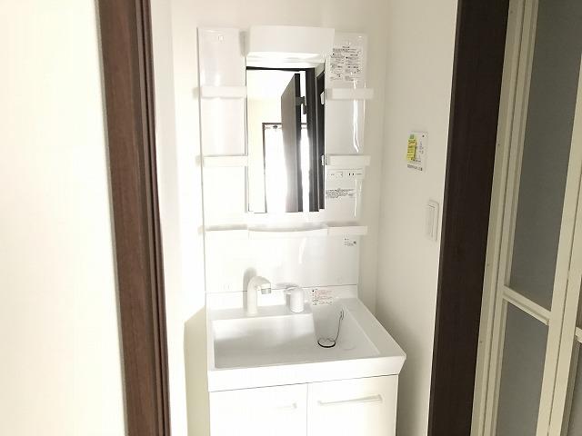 ウェルコーポ星川 203号室の洗面所