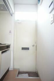 コーポニートネス 203号室の玄関