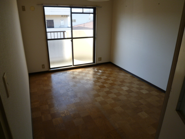 ファミール'21 303号室のベッドルーム