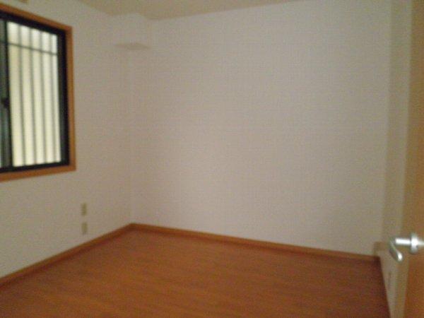 グリーンフラットC 102号室のベッドルーム