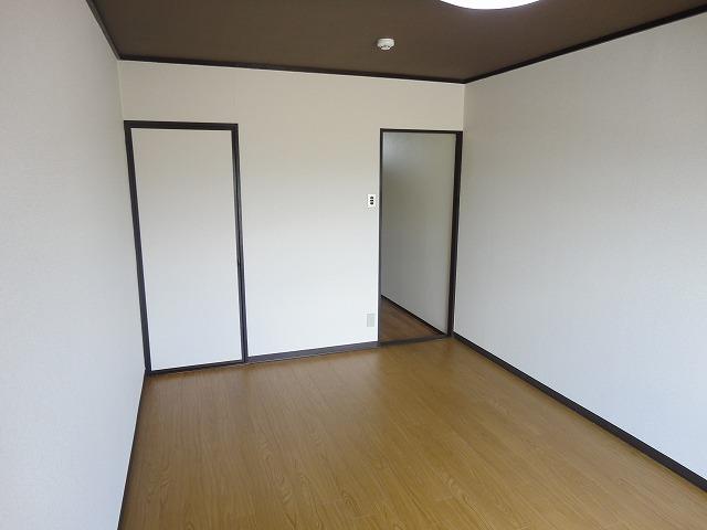 ユニメント桂川 201号室のベッドルーム