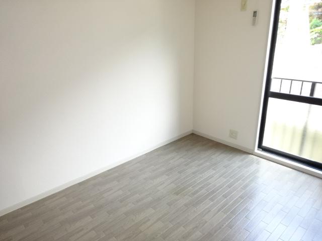 ポルコスピーノK 201号室のベッドルーム