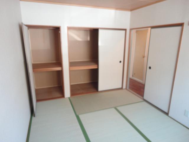 プレジールK 105号室のベッドルーム