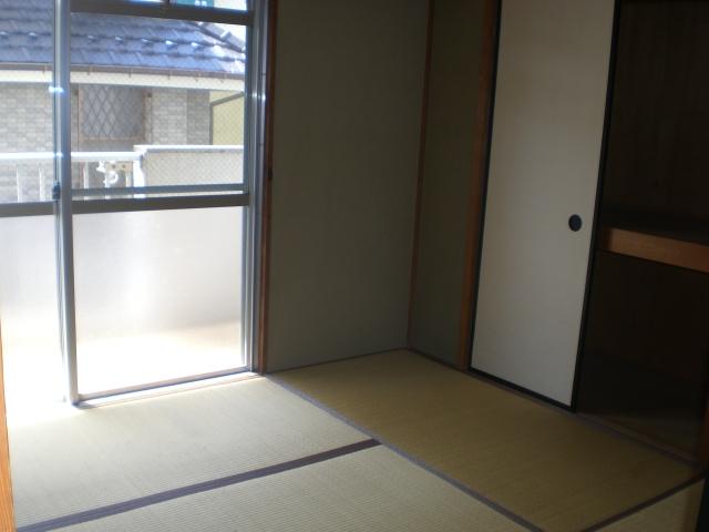 ホワイトピアあけぼの 103号室のベッドルーム