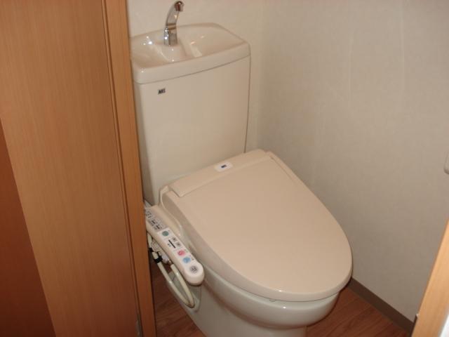 コンフォール三宅 101号室のトイレ