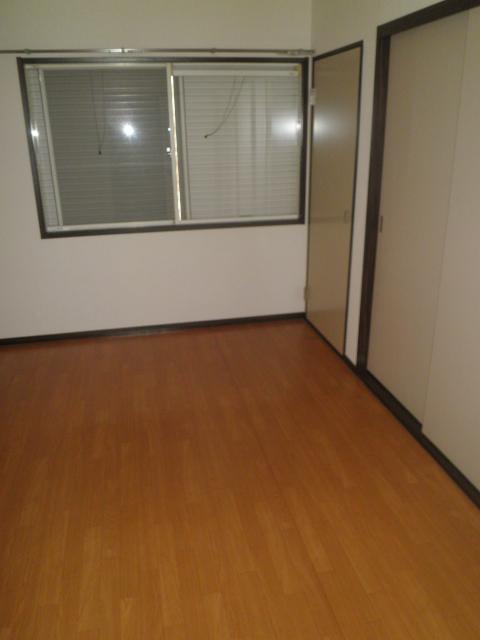 アルカディアプラック B101号室のベッドルーム