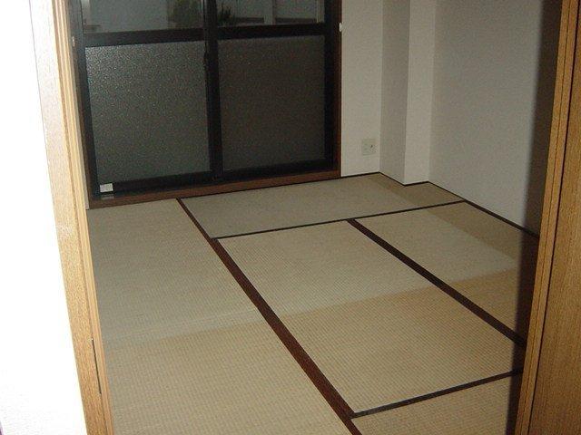 イーストリッチ 208号室のベッドルーム