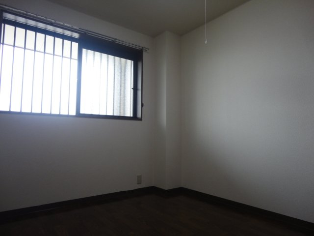 コンフォースB 201号室のベッドルーム