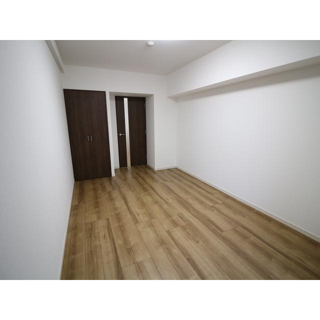 プレール・ドゥーク西新井 101号室のリビング