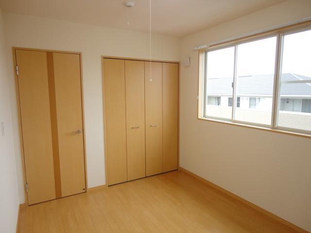 ルミエールB 202号室のベッドルーム
