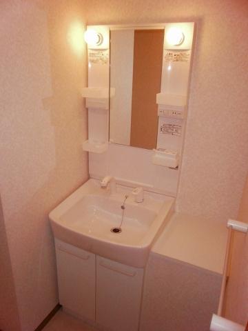 THE FAR SOUTH EAST 104号室の洗面所