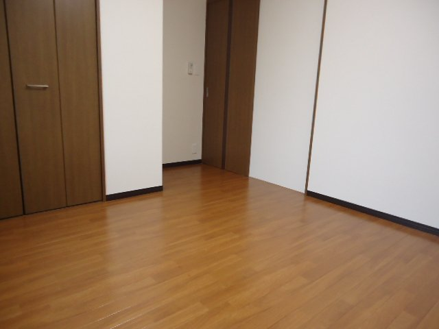 コンフィード 00103号室のベッドルーム