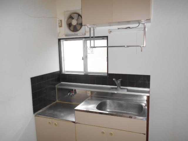 タウニー大縄場 202号室のキッチン