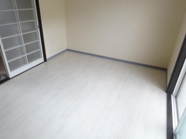ブルーインKIMURA 203号室のベッドルーム