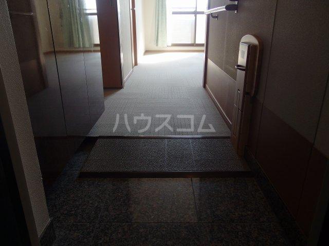 多摩南平パークスクエア 1103号室の玄関