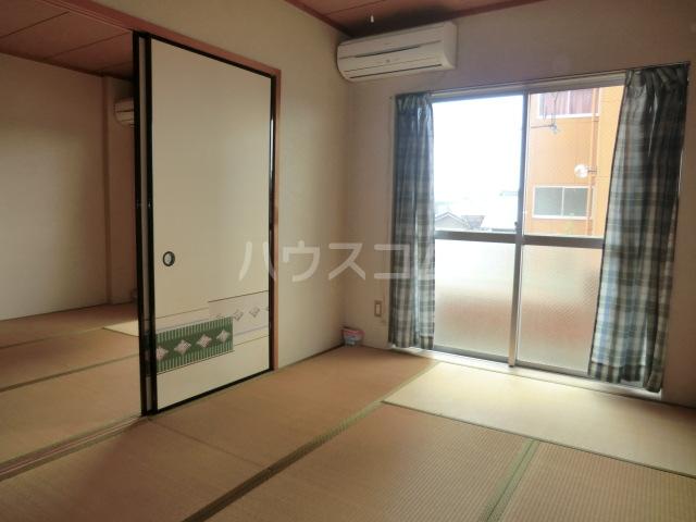 メゾン北郷A棟 203号室の居室