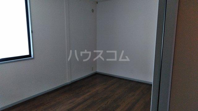 サンビレッジこいけA 201号室のベッドルーム