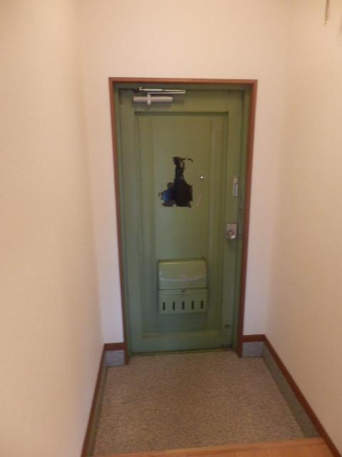 グリーンカーサ坂野 102号室の玄関