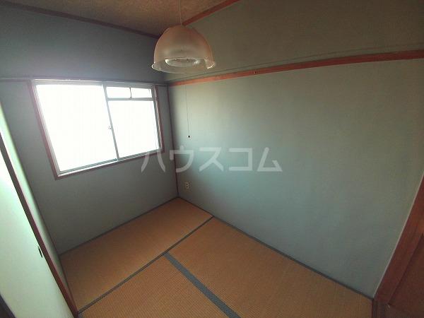 マンションTU 203号室のベッドルーム