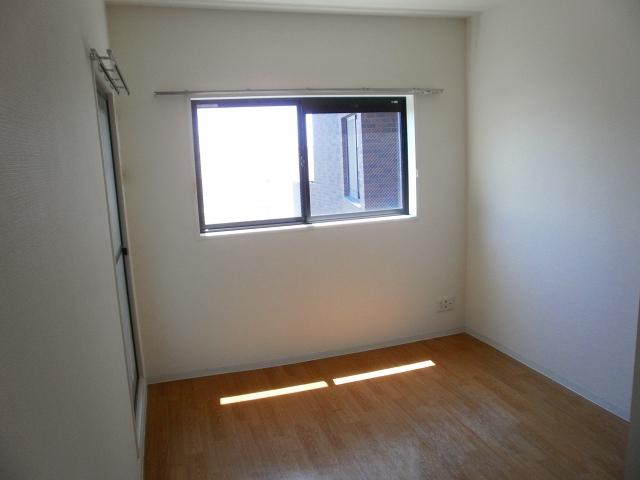 Bonheur衣丘 201号室のベッドルーム