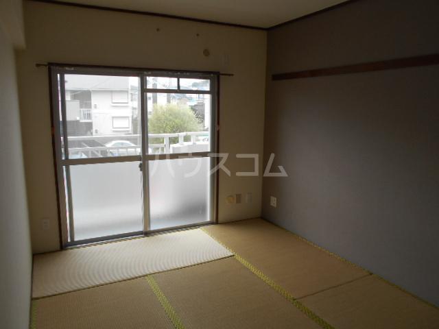 カネコハイツ 202号室のベッドルーム
