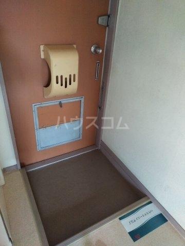 柿生サンハイツ 203号室の玄関
