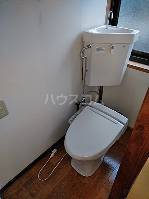 栗橋国分アパートA号棟 A202号室のトイレ