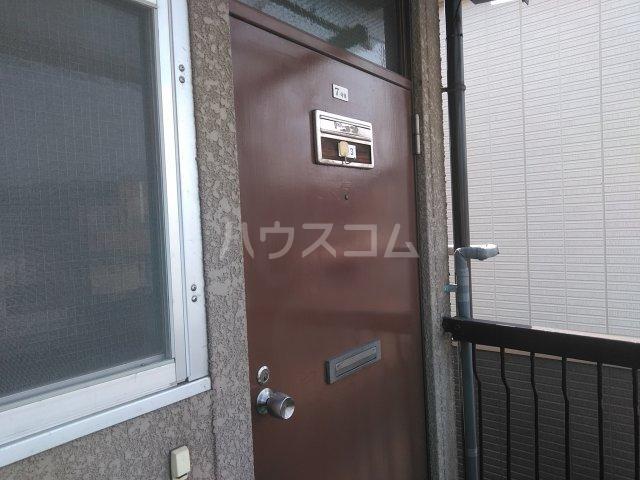 ハウザー高松 203号室の玄関