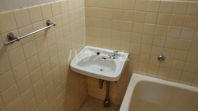 第12通南ビル 203号室の洗面所
