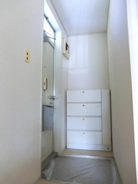 須賀コーポ 102号室の玄関