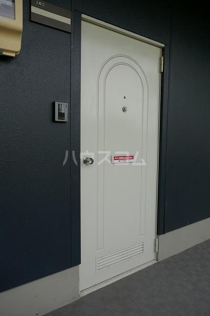 ミュゲー二番館 105号室の玄関