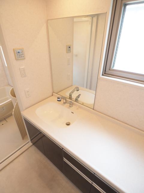 ライジング泉H・Mビル 602号室の洗面所