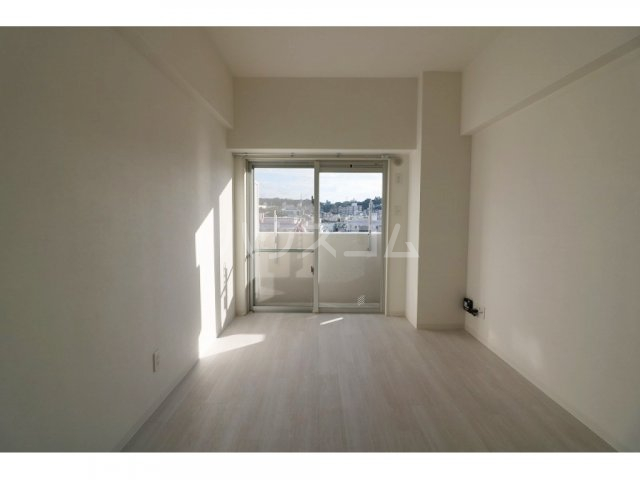 プルミエール牧港 601号室のベッドルーム