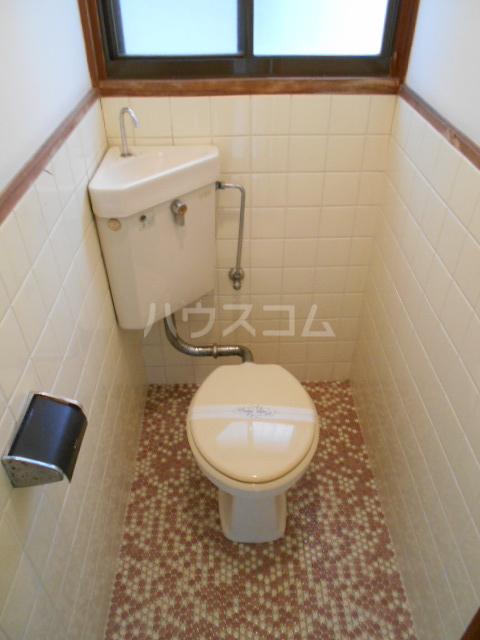 ユニメント祖原 202号室のトイレ