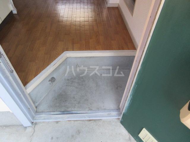 メゾンこなんA 101号室の玄関