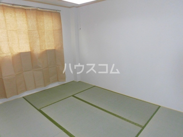 サープラスYAMADA A102号室のベッドルーム