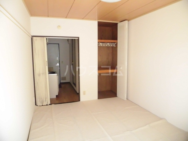 サンシティ クシマ 202号室のベッドルーム