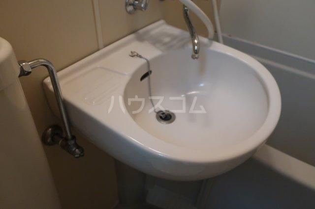 ボナール金山 105号室の洗面所