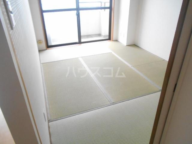 リバーサイド橋忠 2D号室のベッドルーム